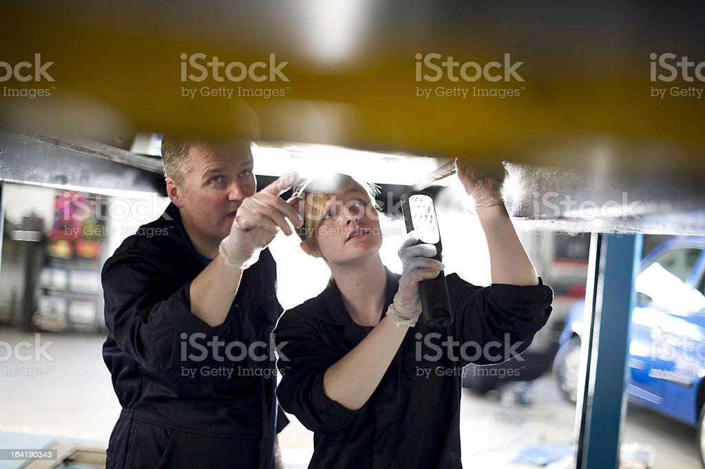 trainee mechanic with boss royalty-free stock photo