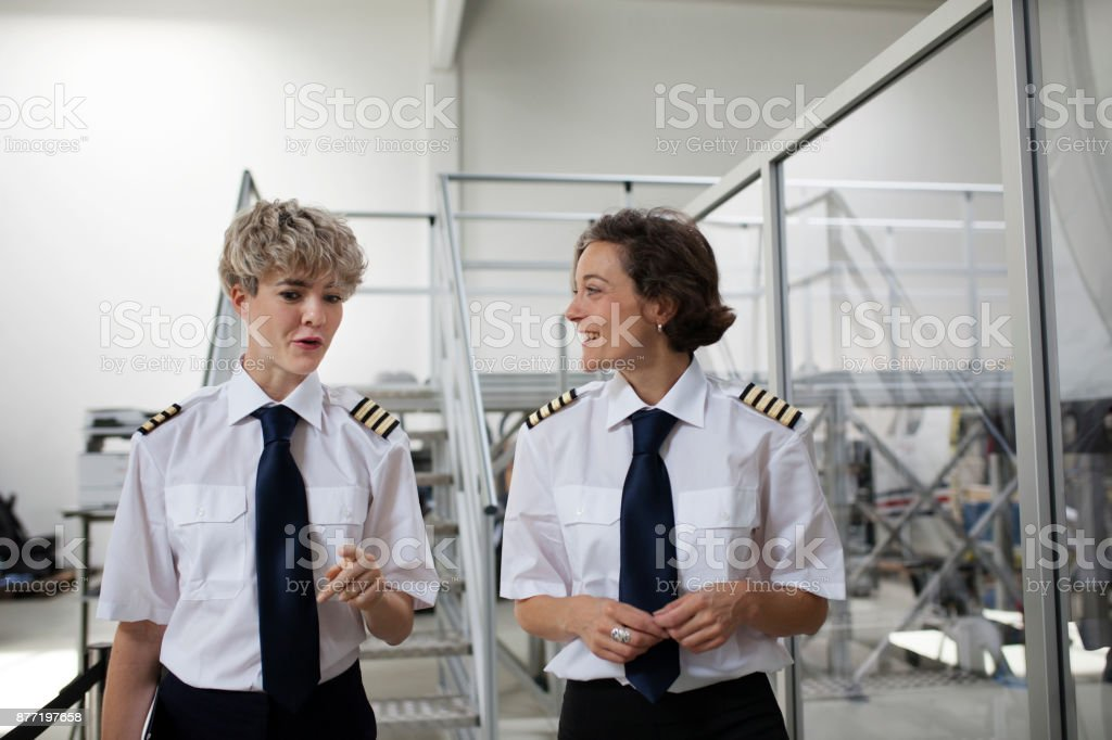 Trainee Pilot And Her Instructor Talking Before Training stock photo