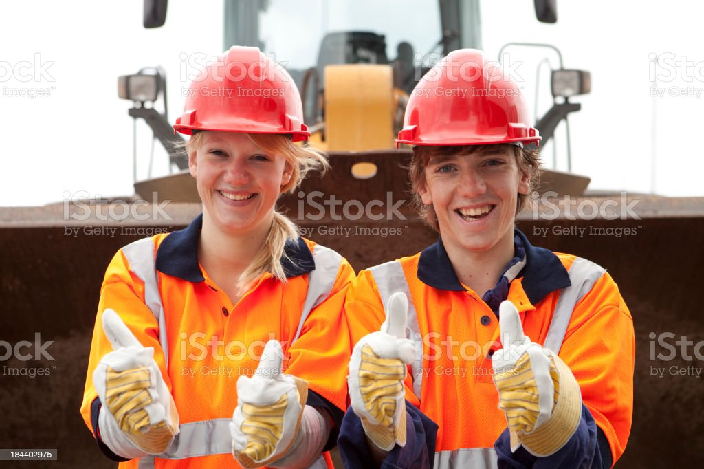 Trainee smiling. Road contruction and industry. royalty-free stock photo