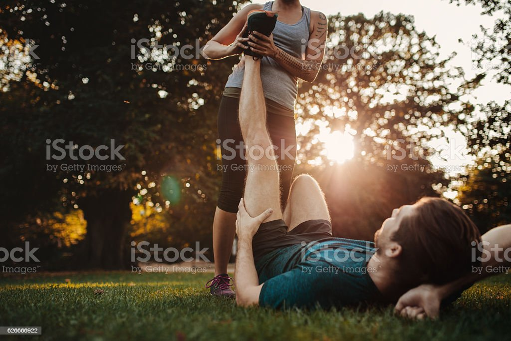 Trainer helping to ease the strain stock photo