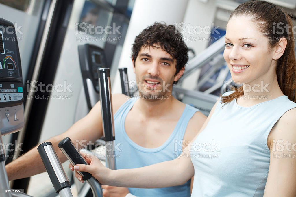 Trainer helping woman on exercise stepper machine. royalty-free stock photo