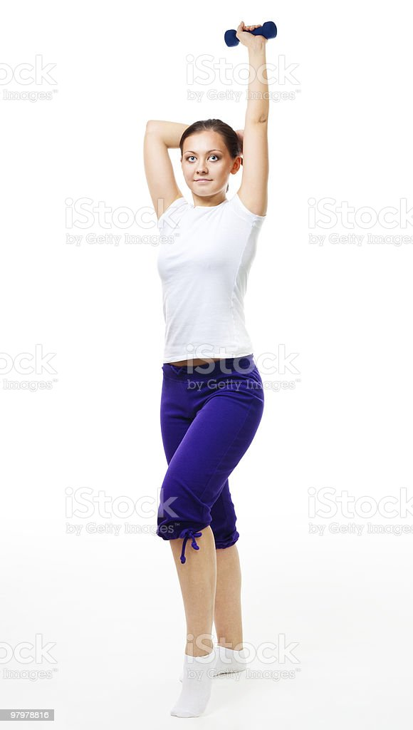 Trainer show exercise with dumbbell royalty-free stock photo