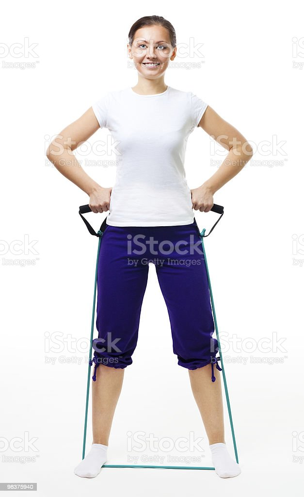 Trainer show exercise with expander royalty-free stock photo