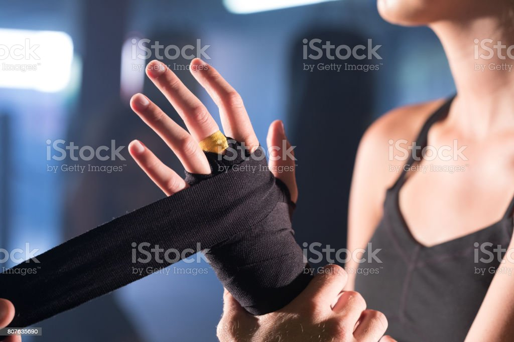 Trainer taping boxers hand stock photo