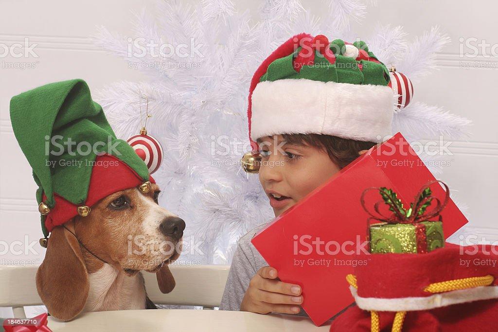 Training a New Christmas Elf royalty-free stock photo
