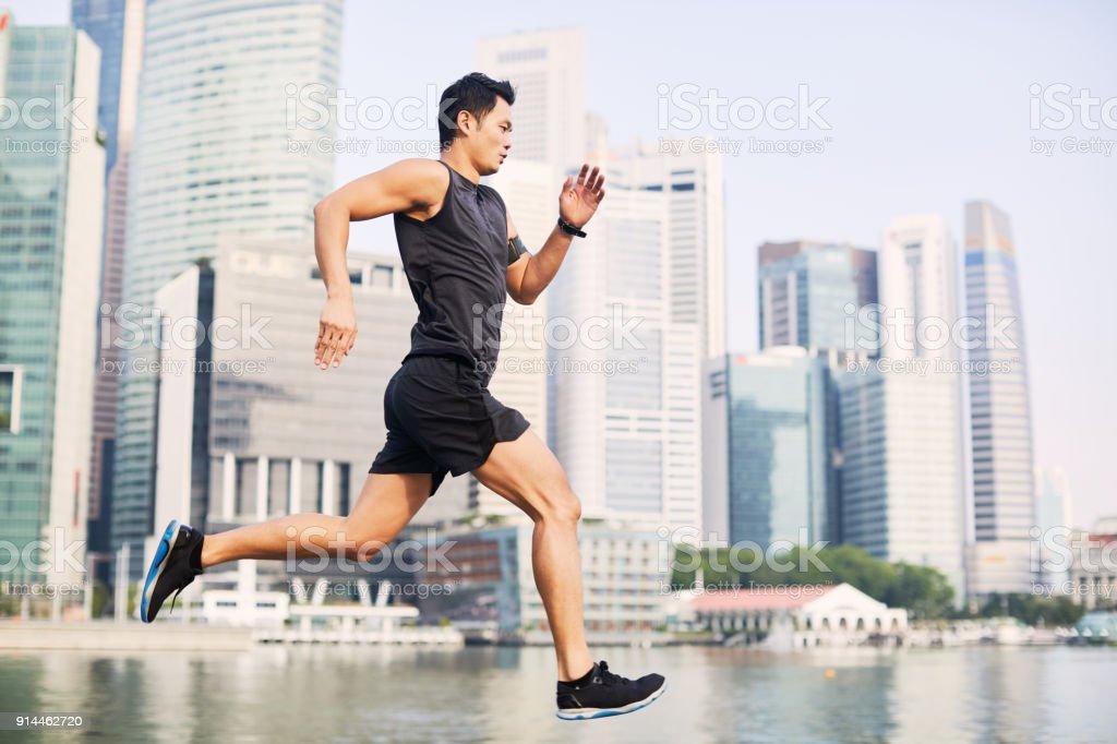 Training and running in Singapore's Marina Bay waterfront, Asia stock photo