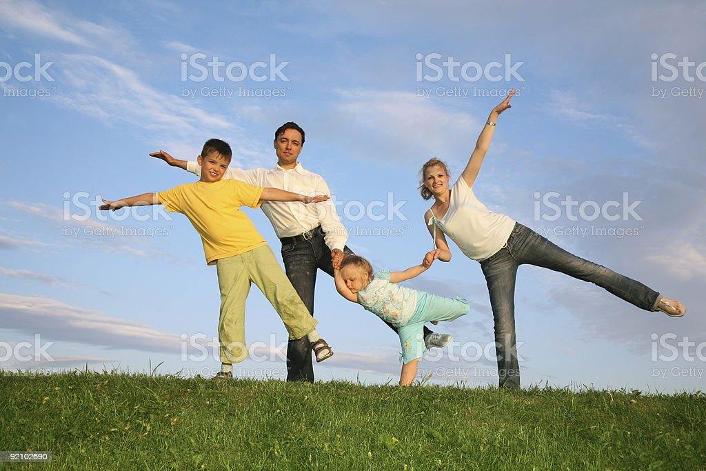 training family grass sky royalty-free stock photo