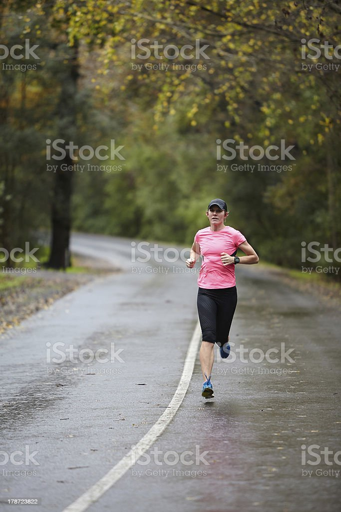 Training for a marathon in wet weather stock photo