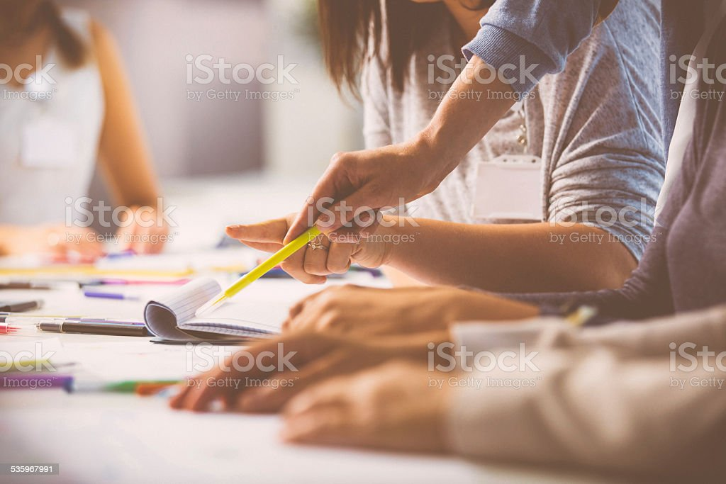 Training for women Group of women attending a training, working together. Close up of hands. Unrecognizable person. 2015 Stock Photo