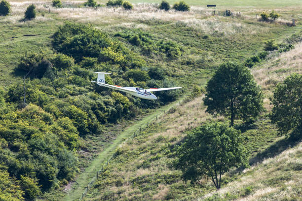 training glider coming in to land - stephen lynn stock pictures, royalty-free photos & images