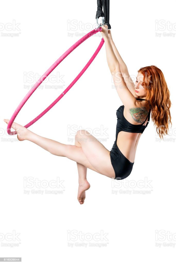 Training in an airy ring on a white background, the girl is isolated stock photo