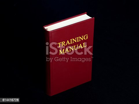815359538 istock photo Training Manual Book Cover on Black Background 614416728