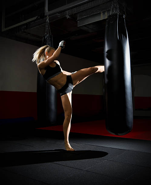 Training of kickboxer woman stock photo