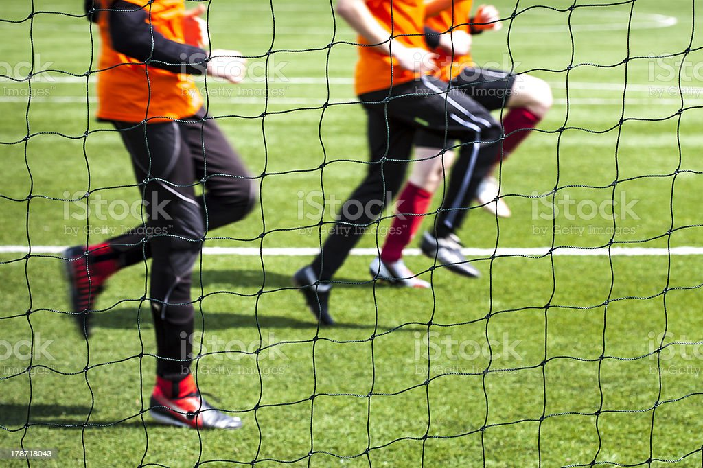 Training of soccer players seen by the grid. stock photo