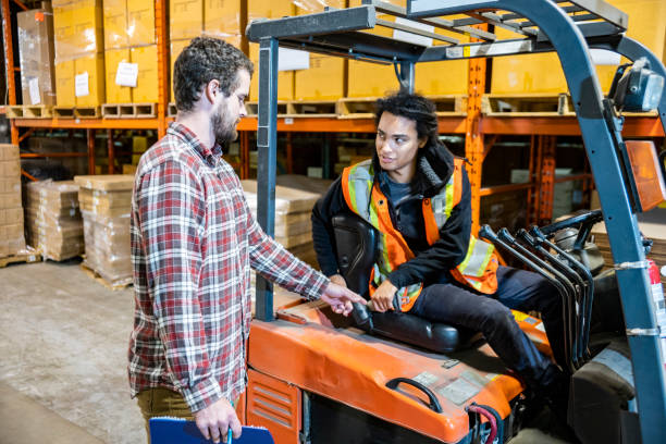Training on forklift safety.  Putting on a seat belt stock photo