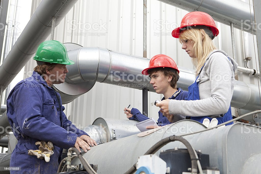 Training outdoors. Trainee making notes. Learning for mechanic. royalty-free stock photo