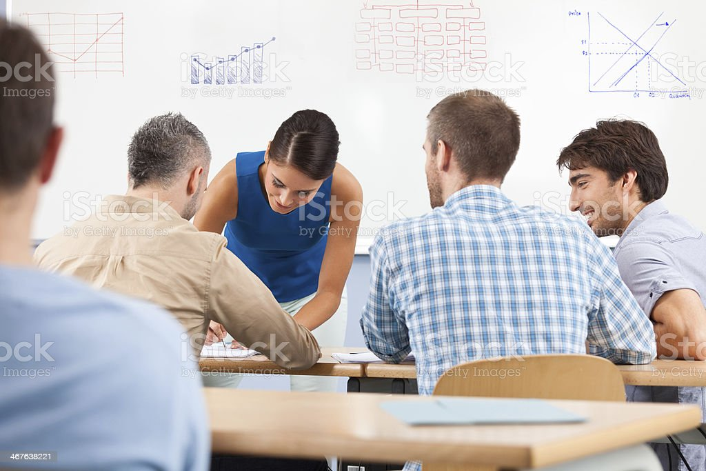 Training Group of people attending a job training, working together. 30-39 Years Stock Photo