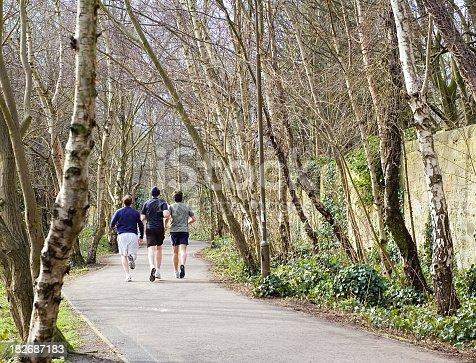 Runners on a public path in Edinburgh.