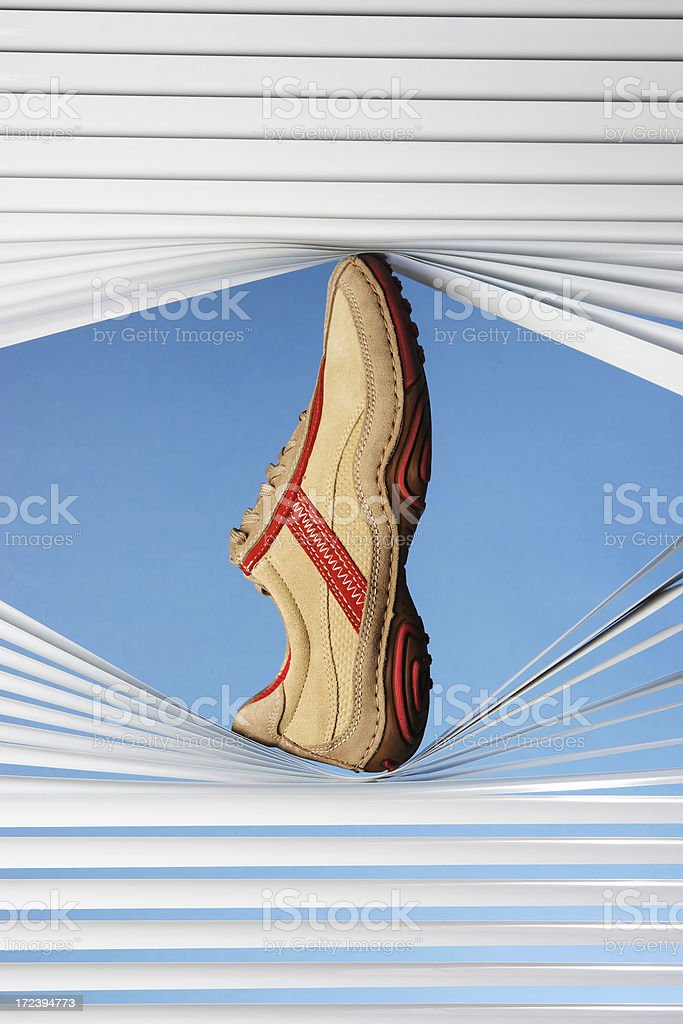 training shoe in a blinds royalty-free stock photo