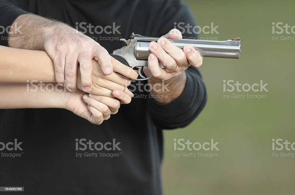 Training someone how to shoot handgun royalty-free stock photo