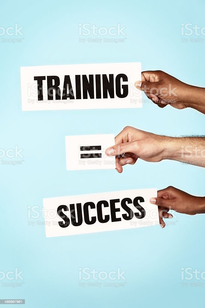 'Training = Success' say hand-held words. Trained staff are vital! stock photo