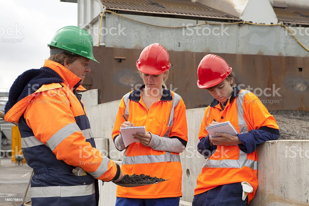 Training to be a construction worker. Trainee making notes. royalty-free stock photo