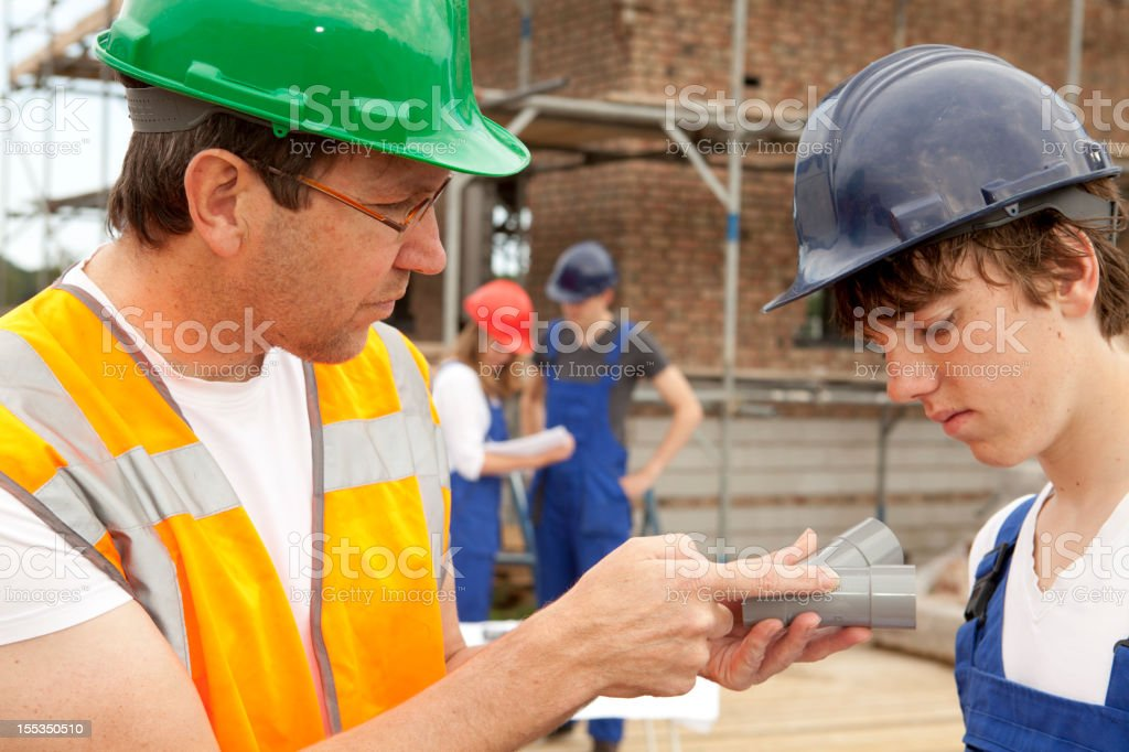 Training to be a plumber. Trainee making notes stock photo