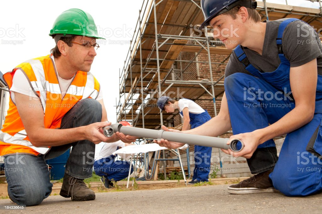 Training to be a plumber. Trainee making notes. royalty-free stock photo