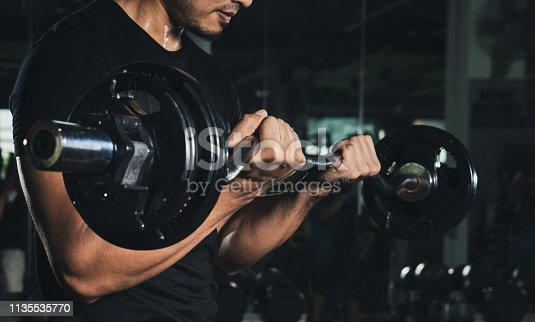 Training with barbell, Athletic shirtless young sports man - fitness model with barbell in gym, Handsome weightlifter preparing for training