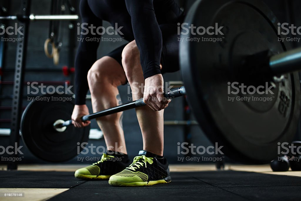 Training with barbell stock photo