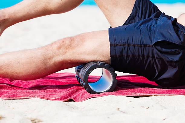 training with blackroll at the beach - blackroll übungen stock-fotos und bilder
