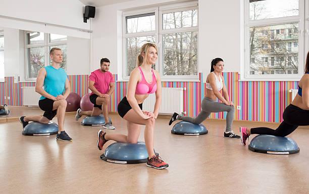 Training with bosu ball stock photo
