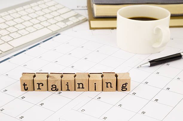 Training wording and timetable on office table stock photo