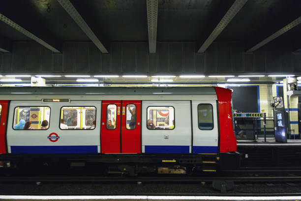 Trains about to depart from Aldgate East tube station London, UK - June 21, 2017 - Trains about to depart from Aldgate East tube station depart stock pictures, royalty-free photos & images