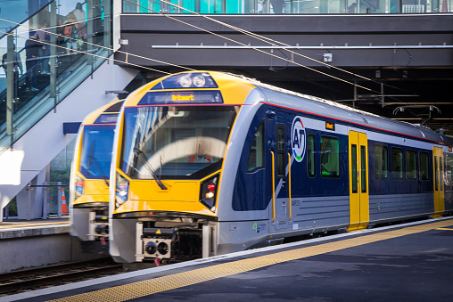 Auckland, New Zealand - February 27th, 2015: One train entering and one train leaving the new Panmure Station.