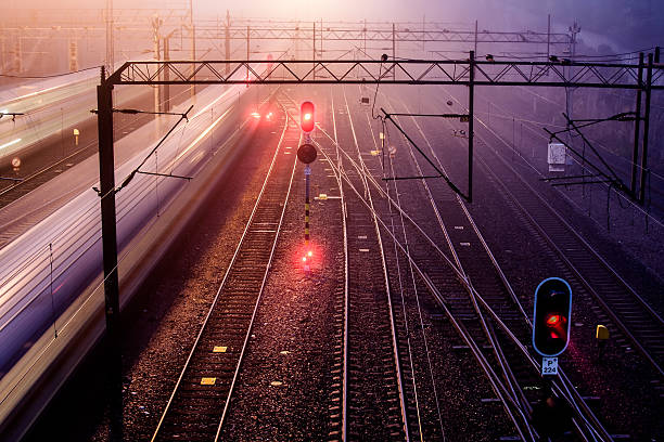 trains with motion blur - railway signal stock photos and pictures