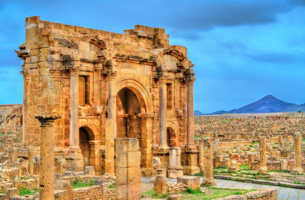 trajan arch within the ruins of timgad in algeria - algeria stock photos and pictures