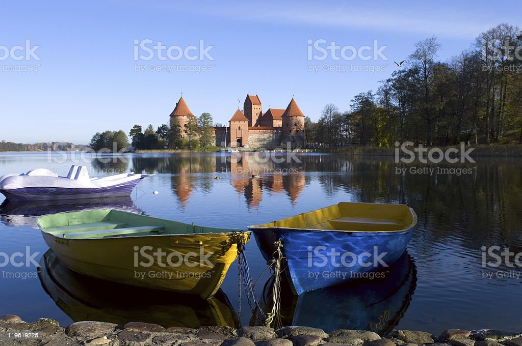 Trakai, Lithuania - boats with a castle in the background stock photo