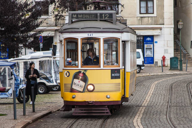 Tram 12 at Largo das Portas do Sol stock photo