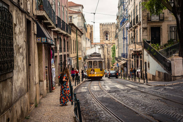 Tram 28 transports tourists through Alfama district in Lisbon, Portugal stock photo