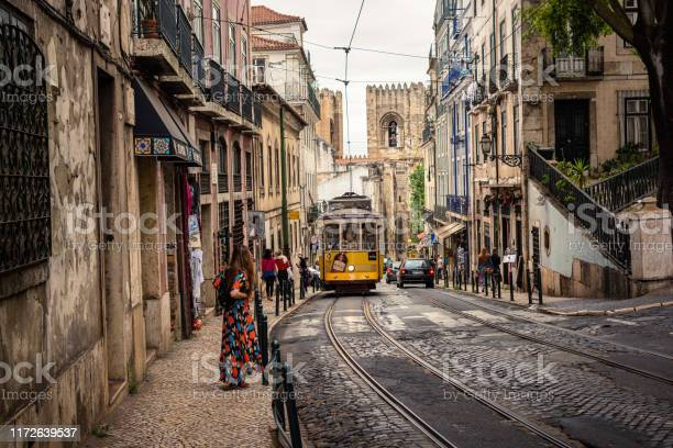 Tram 28 Transports Tourists Through Alfama District In Lisbon Portugal Stock Photo - Download Image Now