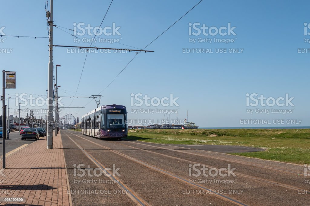 Tram and the tram lines along the seafront in Blackpool stock photo