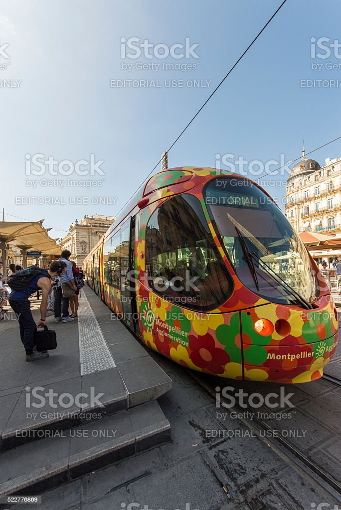 Tram Arrives at Comedie in Montpellier stock photo