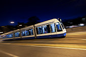 Tram at night with panning motion in Amsterdam