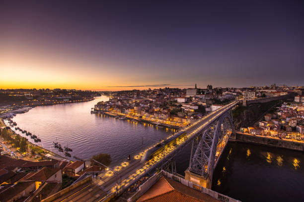 tram crossing from porto to vila nova de gaia at dusk - halbergman stock pictures, royalty-free photos & images