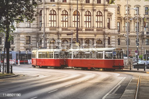 Old fashioned tram goes by the street of Vienna. Vienna is a capital and largest city of Austria