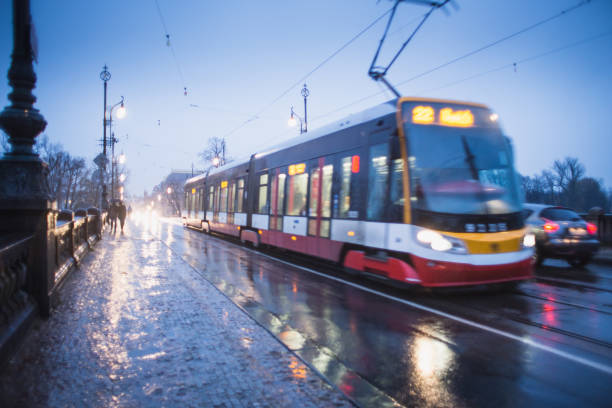 tram going over the bridge in the rain in Prague, blurred motion stock photo