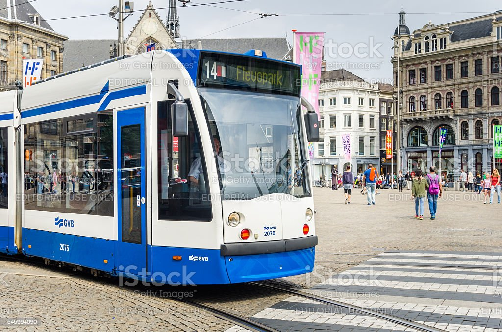 Tram in Amsterdam City Centre on a Sunny Day - Photo