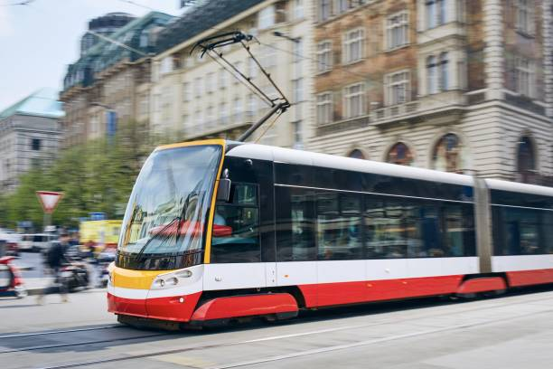 Tram in blurred motion Daily life in the city. Modern tram of public transportation in blurred motion. Traffic at Wenceslas Square, Prague, Czech Republic. wenceslas square stock pictures, royalty-free photos & images