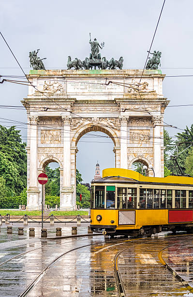 Tram in Milan Tram with Arco della Pace in the background zug stock pictures, royalty-free photos & images